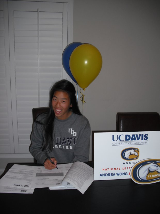 Andrea Wong signs with UC Davis.