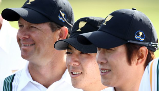 Retief Goosen, left, with fellow Internationals Ryo Ishikawa and K.T. Kim.