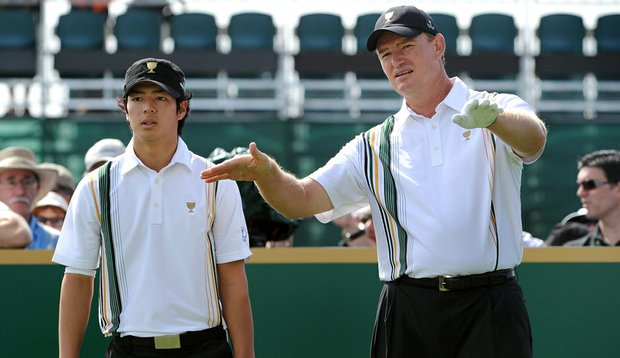 Ryo Ishikawa listens as Ernie Els talks him around Royal Melbourne in a Presidents Cup practice session.