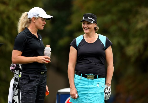 Maria Hjorth, of Sweden, right, talks with Suzann Pettersen, left, of Norway on Thursday at the CME Group Titleholders at Grand Cypress in Orlando, Fla.