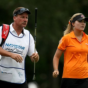 Lexi Thompson with her dad/caddie Scott on Thursday at the CME Group Titleholders at Grand Cypress in Orlando, Fla.