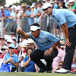 International team duo K.J. Choi and Adam Scott look at a putt on the 12th hole during the Day 1 Foursome matches.