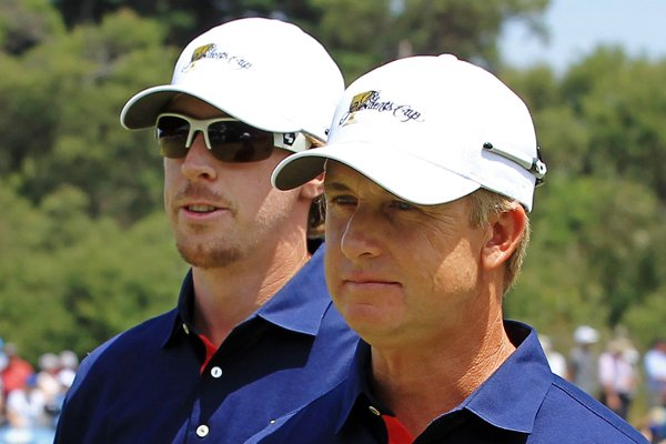 Hunter Mahan of the U.S. and teammate David Toms walk off the first hole during the Day One Foursome matches.