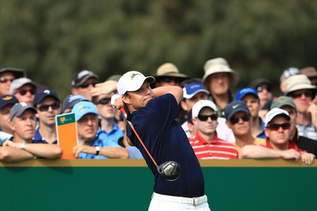 Nick Watney of the U.S. tees off on the 18th hole during the Day One Foursome matches at the 2011 Presidents Cup.