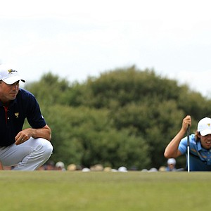 Matt Kuchar of the U.S. and Aaron Baddeley of the International team look at their putts on the 5th hole during the Day 1 Foursome matches at the 2011 Presidents Cup.
