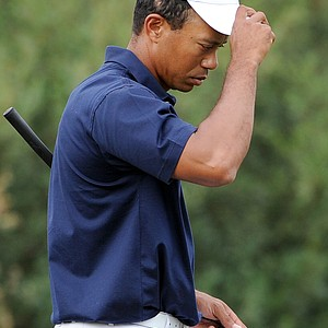 Tiger Woods of the U.S. walks off the green after he and teammate Steve Stricker were defeated by the International team pairing of Adam Scott and K.J. Choi on the opening day of the 2011 Presidents Cup.