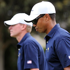 Tiger Woods of the U.S. walks to the green as he and teammate Steve Stricker are defeated by the International pairing of Adam Scott and K.J. Choi on the opening day of the 2011 Presidents Cup.