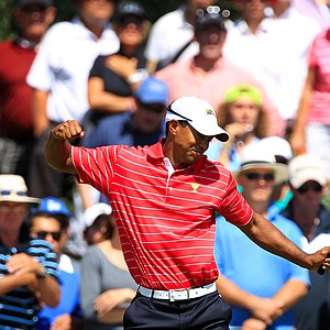 Tiger Woods of the U.S. team reacts to his putt on the fourth hole during the Day Two Four-Ball matches of the 2011 Presidents Cup.