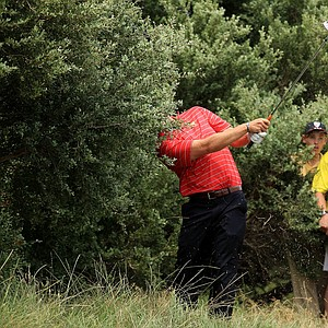Hunter Mahan of the U.S. team plays a shot out of the rough on the eight hole during the Day Two Four-Ball matches of the 2011 Presidents Cup.