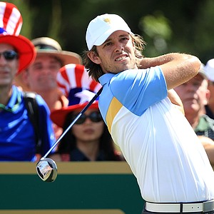 Aaron Baddeley of the International team hits his tee shot on the second hole during the Day Two Four-Ball matches of the 2011 Presidents Cup.