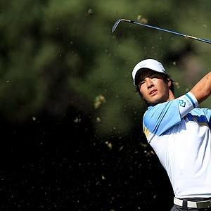 Ryo Ishikawa of the International team hits his second shot on the first hole during the Day Two Four-Ball matches of the 2011 Presidents Cup.