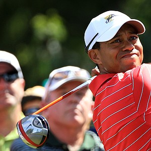 Tiger Woods of the U.S. team hits his tee shot on the second hole during the Day Two Four-Ball matches of the 2011 Presidents Cup.