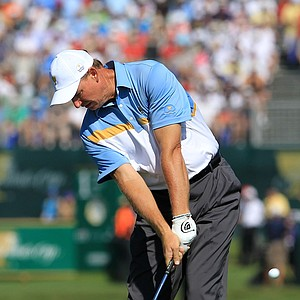 Ernie Els of the International team plays his second shot on the 1st hole during the Day Two Four-Ball matches of the 2011 Presidents Cup.