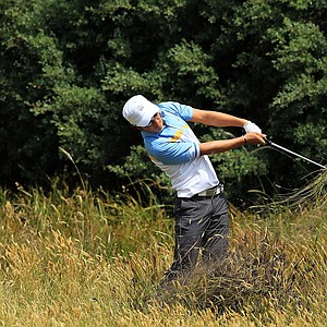 Ryo Ishikawa of the International team hits his second shot on the eighth hole during the Day Two Four-Ball matches of the 2011 Presidents Cup.