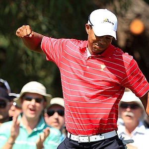 Tiger Woods of the U.S. team reacts to his putt on the fourth hole during the Day Two Four-Ball matches of the 2011 Presidents Cup