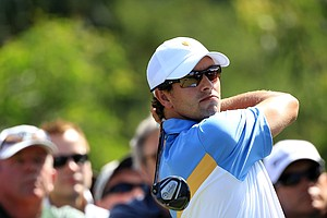 Adam Scott of the International team hits his tee shot on the second hole during the Day Two Four-Ball matches of the 2011 Presidents Cup.