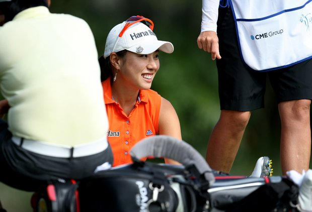 Hee Young Park chats with Yani Tseng while waiting at No. 12 on Friday at the CME Group Titleholders at Grand Cypress. Park shot posted a 69 on Friday and moved from T20 to T3.