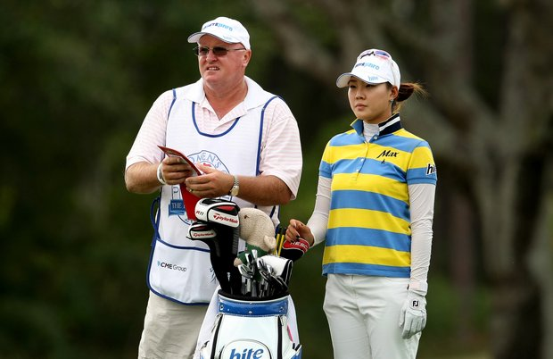 Hee Kyung Seo with her caddie Dean Herden at No. 8 on Friday at the CME Group Titleholders at Grand Cypress in Orlando, Fla.