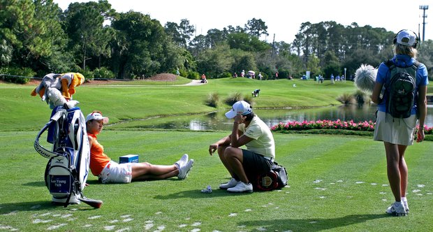Hee Youing Park and Yani Tseng chat while waiting at No. 12 on Friday at the CME Group Titleholders at Grand Cypress in Orlando, Fla.