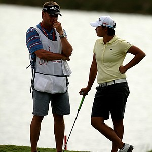 Yani Tseng and her caddie Jason Hamilton chat at No. 18 on Friday at the CME Group Titleholders at Grand Cypress in Orlando, Fla.