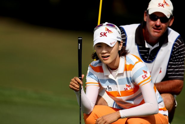 Na Yeon Choi and her caddie discuss her putt at No. 10 on Friday at the CME Group Titleholders at Grand Cypress in Orlando, Fla.