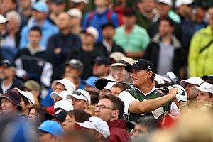Ernie Els of the International team watches his tee shot on the 18th hole amidst a gallery of fans during the Day Three morning foursome matches at the 2011 Presidents Cup.