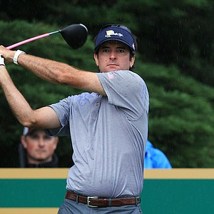 Bubba Watson of the U.S. plays a tee shot on the 14th hole during the Day Three morning foursome matches at the 2011 Presidents Cup.