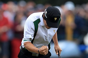 Ryo Ishikawa of the International team celebrates making a putt on the 17th hole during the Day Three morning foursome matches of the 2011 Presidents Cup.