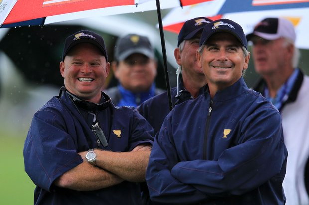 U.S. team captain Fred Couples, right, watches play during the Day Three morning foursome matches of the 2011 Presidents Cup. The U.S. ran out to a 11-6 lead after the foursomes.