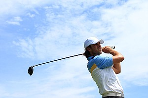 Aaron Baddeley of the International team plays his tee shot on the 15th hole during the Day Two Four-Ball matches of the 2011 Presidents Cup.