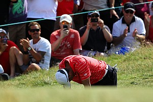 Tiger Woods of the U.S. team reacts to missing a putt for birdie on the 18th hole during the Day Two Four-Ball matches of the 2011 Presidents Cup.