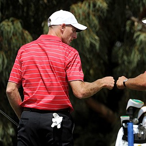 Phil Mickelson, right, and Jim Furyk of the U.S. beat Adam Scott and K.T. Kim 2 and 1 to move to 2-0 at the 2011 Presidents Cup.