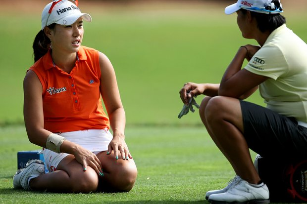 Hee Young Park (left) chats with Yani Tseng during while waiting to tee off on No. 12 at Grand Cypress.