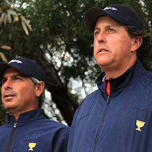 U.S. captain Fred Couples and player Phil Mickelson of the U.S. look on at the eighth hole during the Day Three afternoon four-ball matches of the 2011 Presidents Cup.