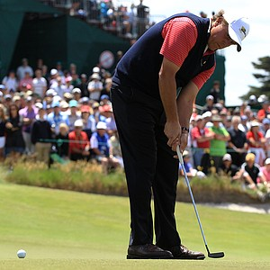 Phil Mickelson of the U.S. putts on the fourth hole during the Day Four singles matches of the 2011 Presidents Cup.