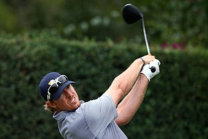Hunter Mahan of the U.S. plays his tee shot on the eighth hole during the Day Three afternoon four-ball matches of the 2011 Presidents Cup.