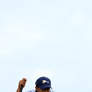 Tiger Woods of the U.S. lines up his his putt on the seventh hole during the Day Three afternoon four-ball matches of the 2011 Presidents Cup.