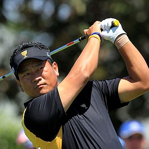 K.J. Choi of the International team hits his tee shot on the third hole during the Day Four singles matches of the 2011 Presidents Cup.