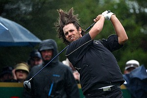 Aaron Baddeley of the International plays his tee shot on the 11th hole during the Day Three afternoon four-ball matches of the 2011 Presidents Cup.