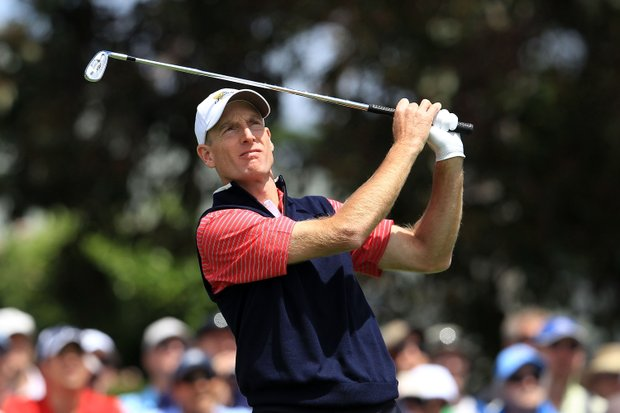Jim Furyk of the U.S. hits his tee shot on the third hole during the Day Four singles matches of the 2011 Presidents Cup.