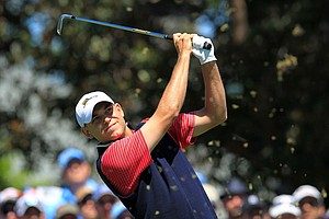 Bill Haas of the U.S. hits his tee shot on the third hole during the Day Four singles matches of the 2011 Presidents Cup.