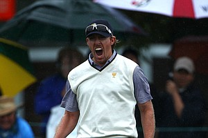 Hunter Mahan of the U.S. celebrates making a putt to win the match during the Day Three afternoon four-ball matches of the 2011 Presidents Cup.