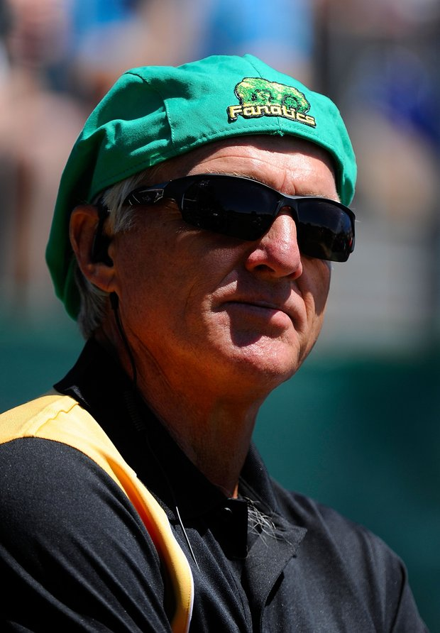 International team captain Greg Norman looks on from the first tee during the Day Four singles matches of the 2011 Presidents Cup.