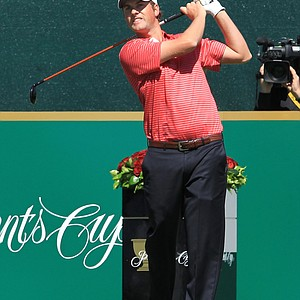 Webb Simpson of the U.S. plays his tee shot on the 1st hole during the Day Four singles matches of the 2011 Presidents Cup.