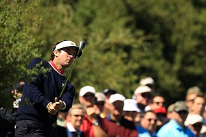 Bubba Watson of the U.S. watches his approach shot on the first hole during the Day Four singles matches of the 2011 Presidents Cup.