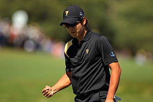 K.T. Kim of the International team reacts to saving par on the first hole during the Day Four singles matches of the 2011 Presidents Cup.