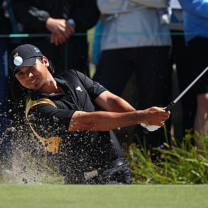 Jason Day of the International team plays a bunker shot on the first hole during the Day Four singles matches of the 2011 Presidents Cup.