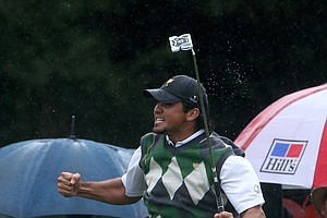 Jason Day of the International team celebrates a putt on the 17th hole during the Day 3 afternoon four-ball matches of the 2011 Presidents Cup.