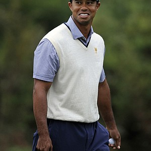 Tiger Woods of the U.S. team smiles as he walks off the eighth green during the third round of the Presidents Cup.