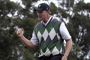 Ernie Els of South Africa celebrates after sinking a putt on the sixth green during the Presidents Cup.
